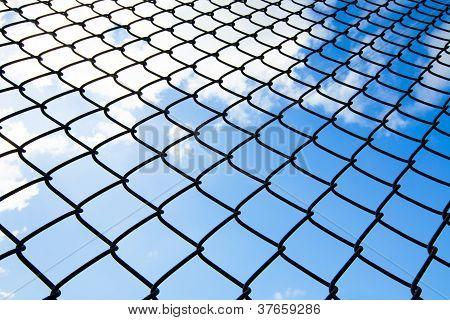 metallic net with sky background