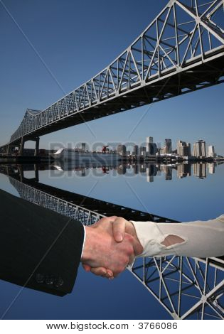 Handshake And New Orleans Skyline