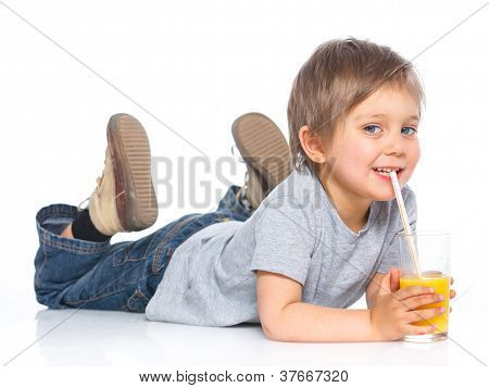 Little boy drinking orange juice