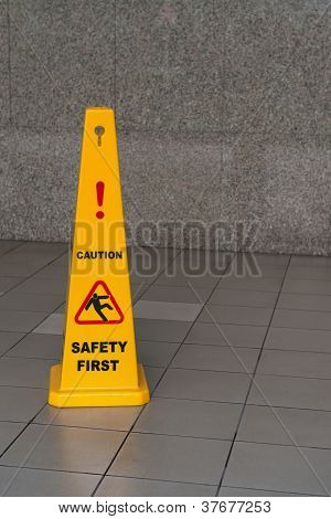 Caution Wet Floor Sign On Tiled Floor