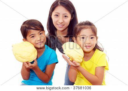 Little girls eating bread