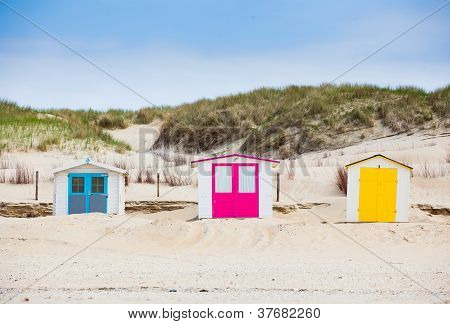 houses on the beach with blue sky