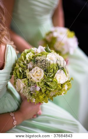 Bridesmaids In Green With Wedding Bouquet