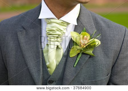 Groom With Orchid Buttonhole At Wedding