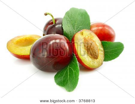 Ripe Plums With Cut And Leaf Isolated