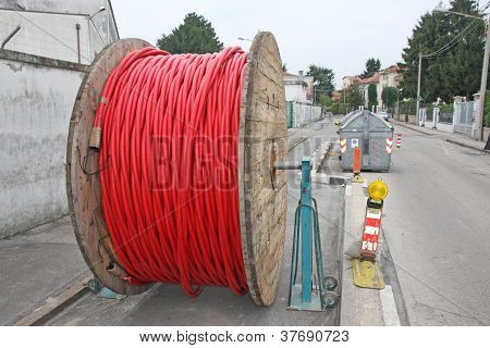 Spool Of Cable And Fiber Optics In The Road During The Outdoor And Underground Laying