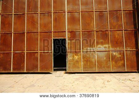 gate with a dark hallway