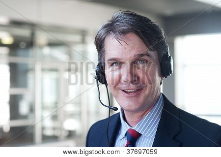 Portrait Of A Mature Businessman With Headset