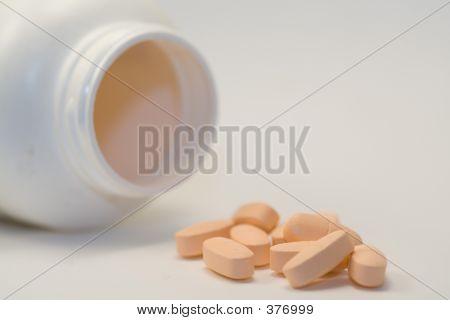 Group Of Orange Vitamin Pills