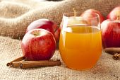 stock photo of cider apples  - Fresh Organic Apple Cider with Apples and Cinnamon