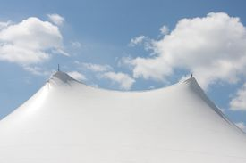 picture of circus tent  - Large White Circus Tent over a Blue Sky and Clouds - JPG