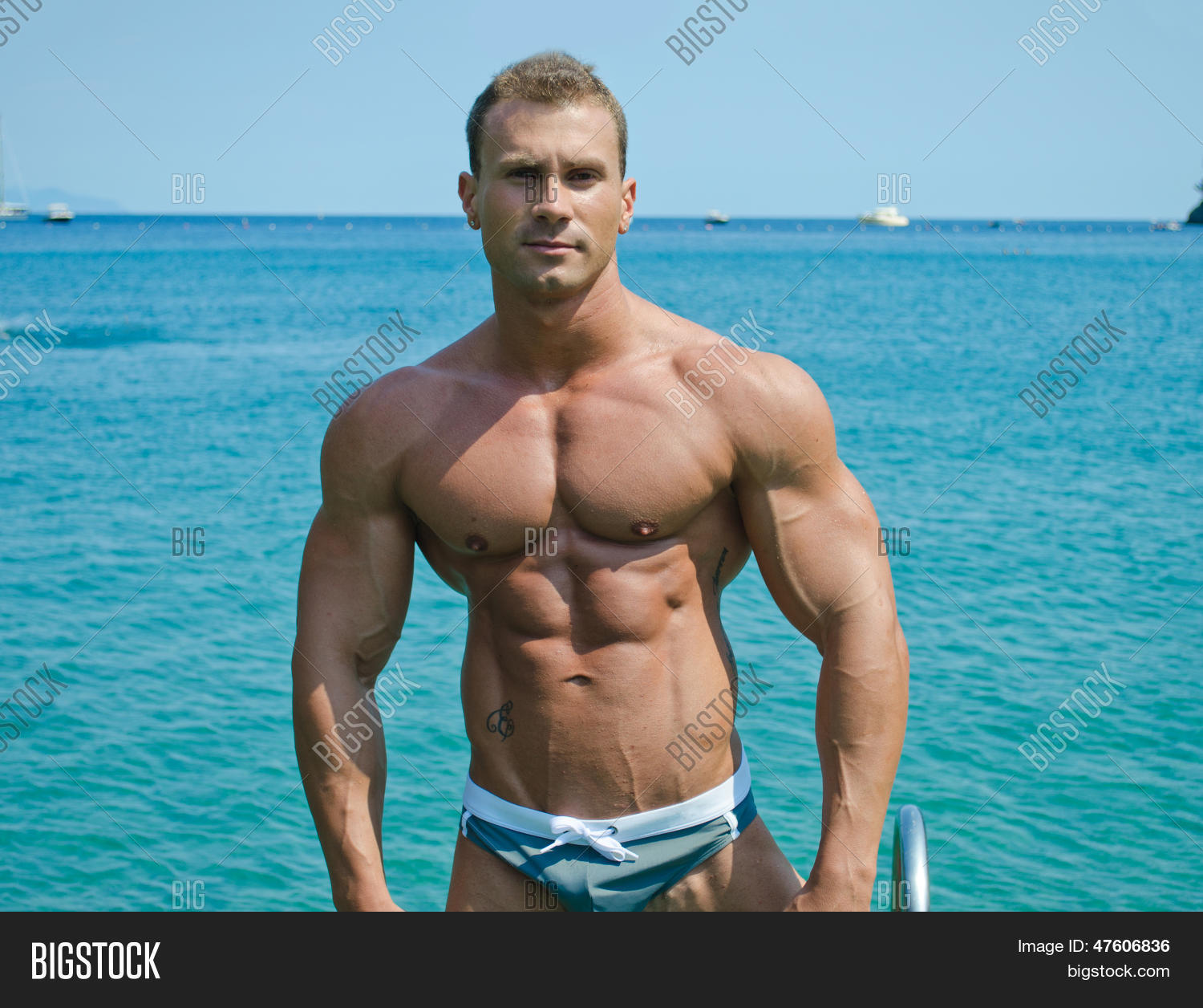 Handsome Young Bodybuilder Standing With Sea Or Ocean