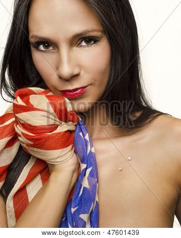 Beautiful face of woman holding American flag