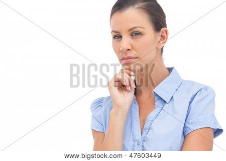 Stern businesswoman with hand on chin looking at the camera