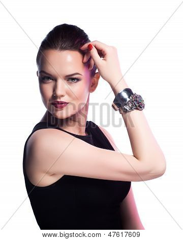 Portrait of beautiful and fashion woman in jewelry.