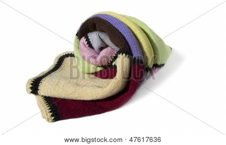 The woolen, multi-colored, knitted plaid is isolated on a white background.