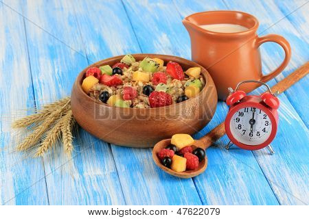 Oatmeal with fruits on table close-up