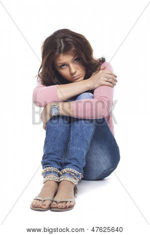 Portrait Of Young Sad Woman On White Background