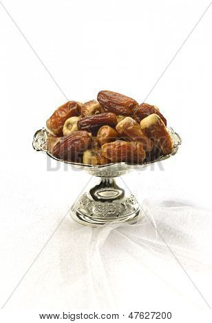 Silver bowl of arabic dates