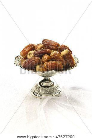 Silver bowl of arabic dates