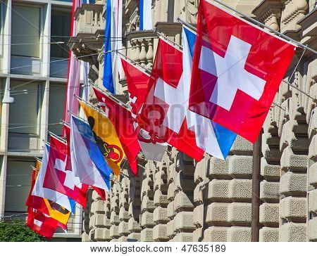 Ancient Paradenplatz square in Zurich decorated with swiss flags