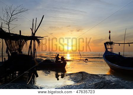 Fisherman Are Sitting On Fishing Boat To Fix Engine