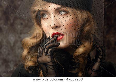 vintage style sensual portrait at veil