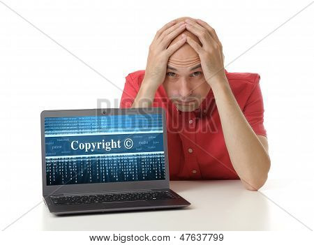 Frustrated Man With Laptop. Copyright Concept