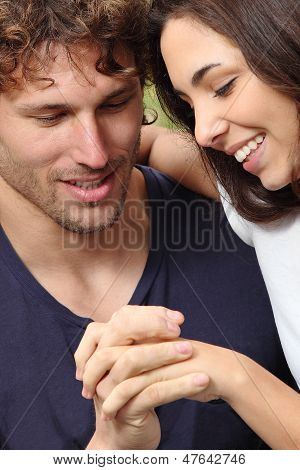 Couple Looking Their Hands