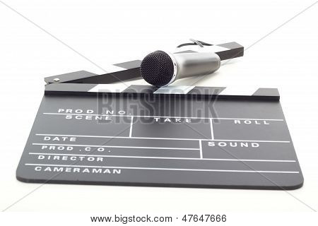 Clapperboard And Microphone On White Background
