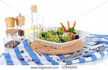 Light salad on plate on napkin