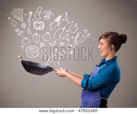 Pretty lady cooking vegetables
