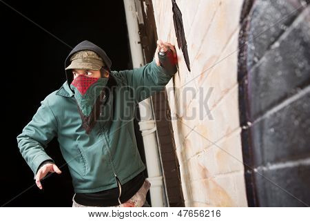 Worried Gang Member Spray Painting