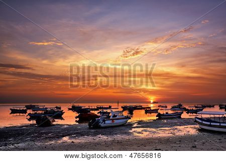 sunrise over fishing boats in Tanjung Benoa, Bali, Indonesia