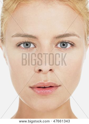 Closeup portrait of a beautiful young blond woman with clean face
