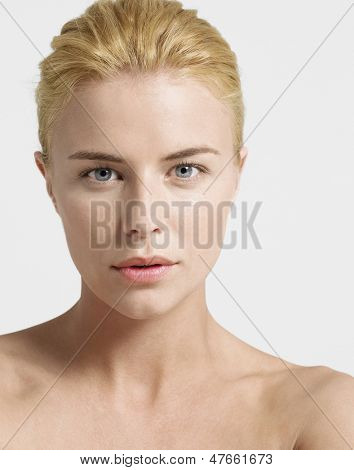 Closeup of a seductive young woman over white background