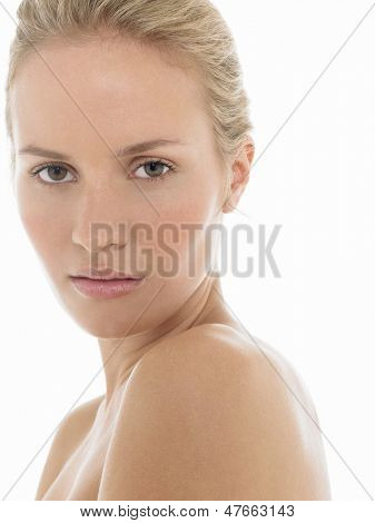 Closeup of a seductive young blonde woman over white background