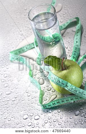 apple glass of water and tape