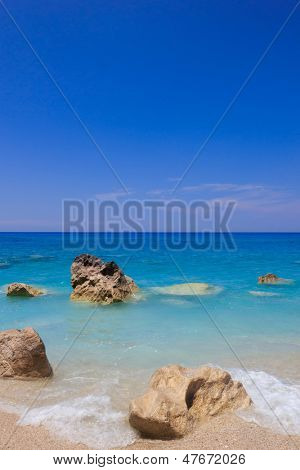 Sandy beach with stones in Kalamitsi Lefkas Greece