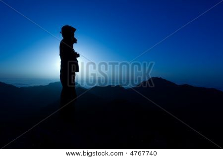 A Silhouette Of Cameraman With Golden Light In The Morning.
