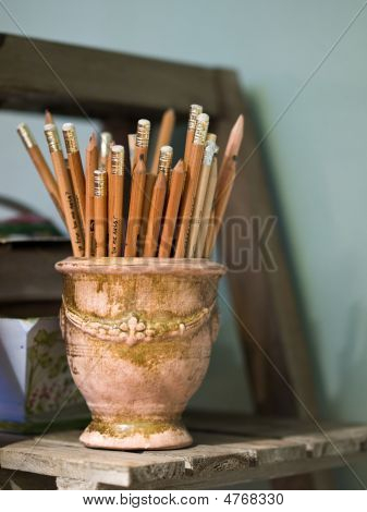 Set Of Wooden Pencils In An Earthen Container