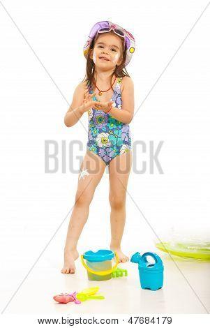 Happy Girl Apply Sunblock Lotion