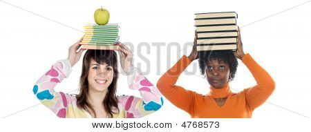 Two Attractive Girls With Books On The Head