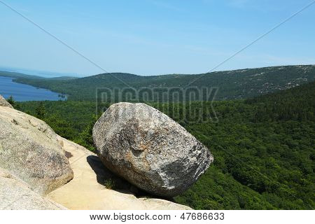 Bubble Rock on top of the South Bubble Mountain and Jordan Pond at Acadia National Park, Maine, USA