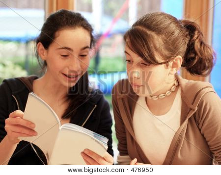 Teenage Girls Reading A Book