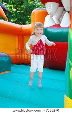 In The Amusement Park, Jumping On An Inflatable Slide Girl.