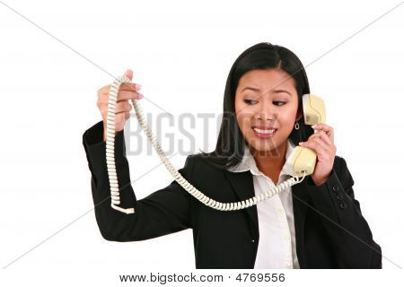 Businesswoman Holding Disconnected Phone Cord