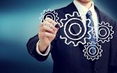 pic of interlock  - Businessman with gears  - JPG
