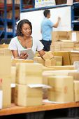 picture of dispatch  - Workers In Warehouse Preparing Goods For Dispatch - JPG