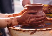 foto of molding clay  - Potter making the pot in traditional style - JPG